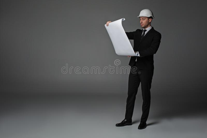 Serious worker watching at plan royalty free stock images