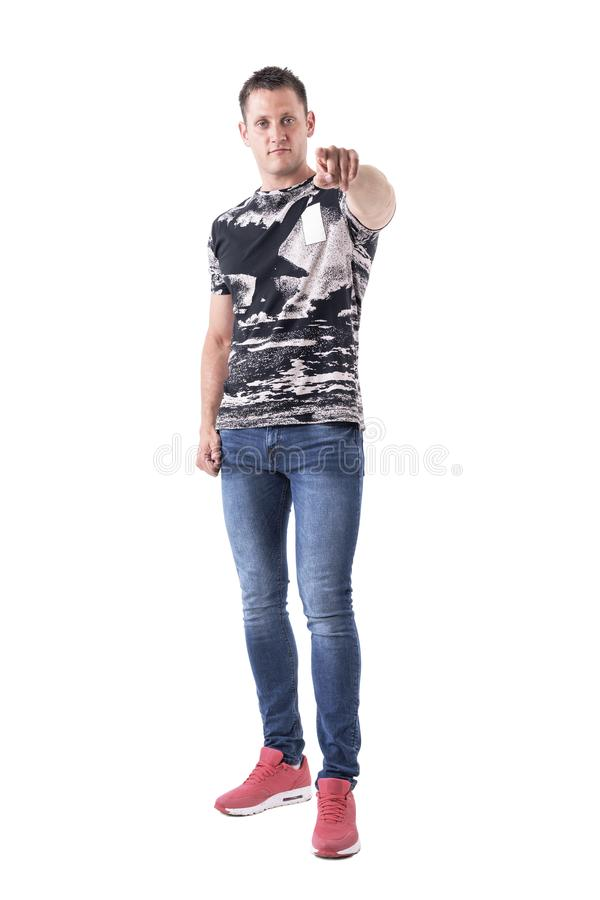 Serious young adult macho man pointing finger at camera to blame or accuse. Full body isolated on white background stock photos