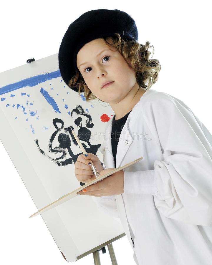 Serious Young Artist With Her Work Stock Photos