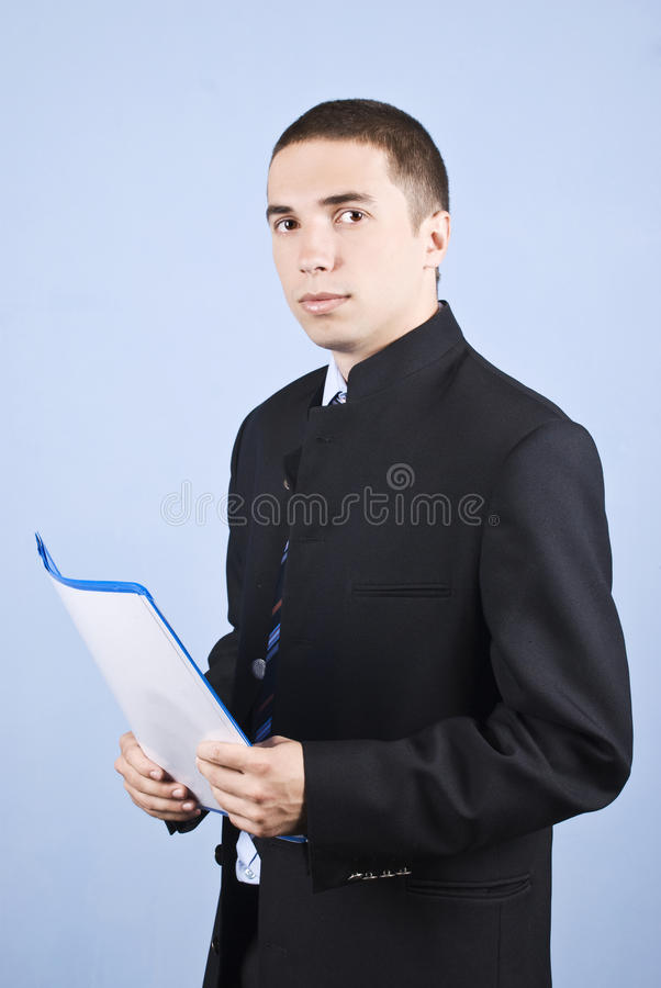 Serious young business man with folder royalty free stock photo
