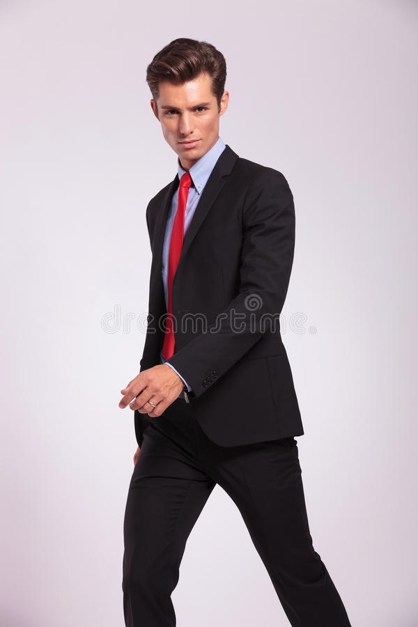 Serious young business man walking