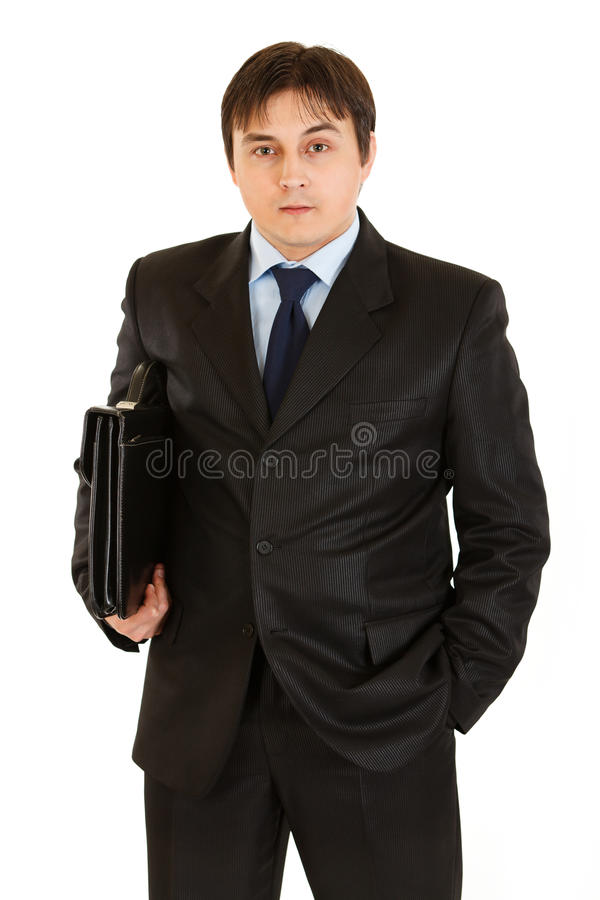 Serious young businessman with briefcase in hand royalty free stock photos