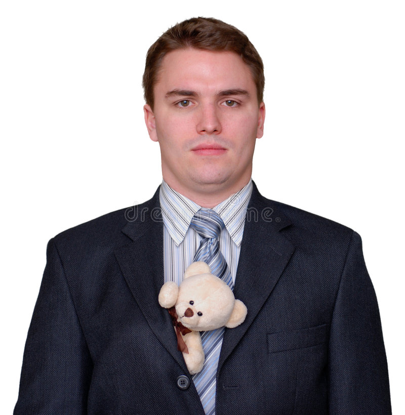 Serious Young Businessman with Teddy Bear in Suit royalty free stock photography