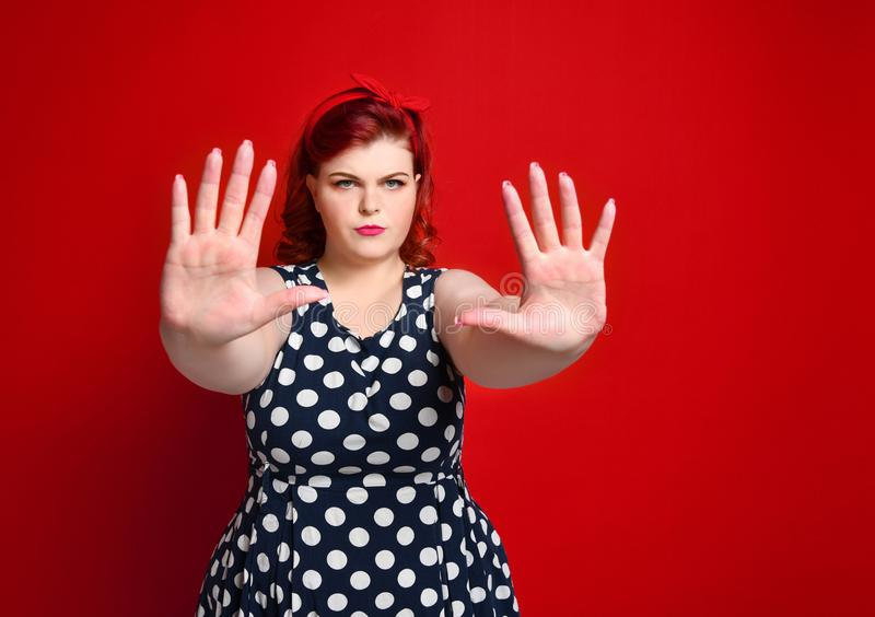 Serious young caucasian woman showing stop gesture with her hand. royalty free stock photos