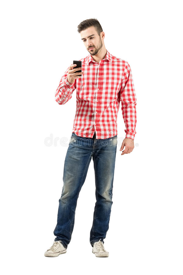 Serious young man taking photo with smartphone stock images