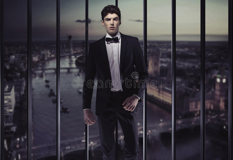 Download Serious Young Man On The Top Of The Building Stock Photo - Image: 30924410