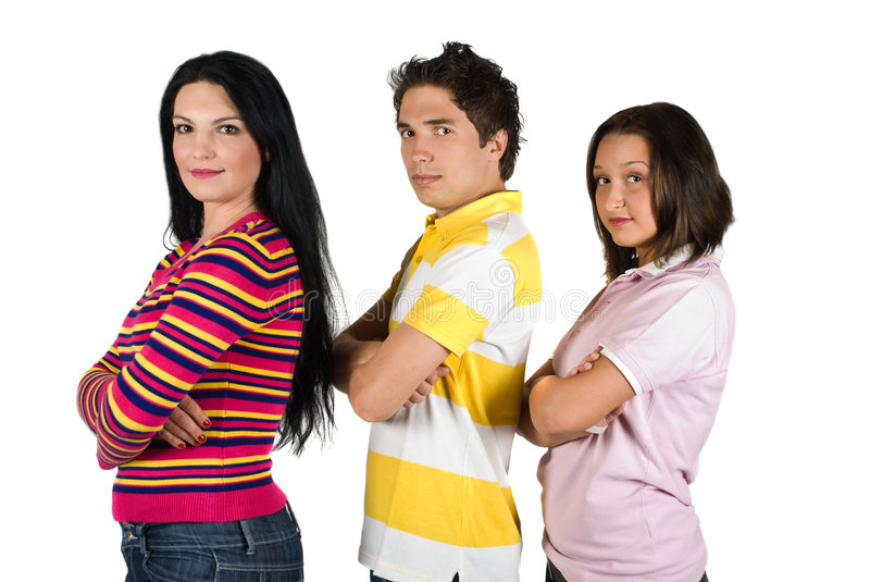 Serious young people. Serious group of three young people standing with hands crossed in a line profile and looking at camera isolated on white background,check stock image