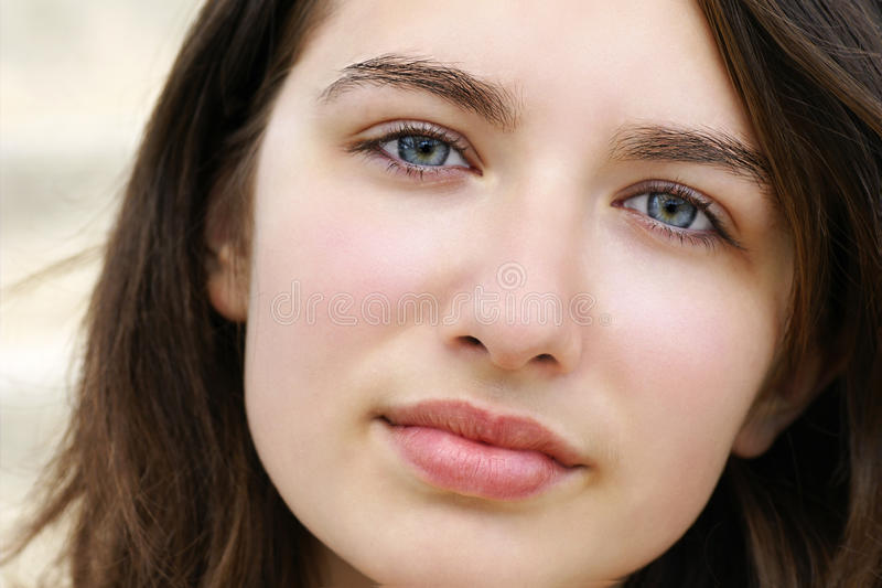 Serious young woman with blue eyes stock photos