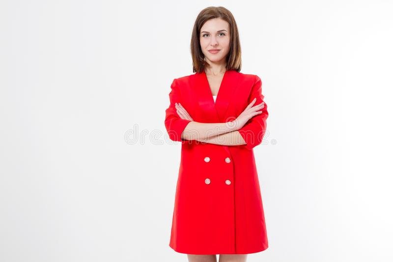 Serious young woman with crossed arms in red dress isolated on white background. Copy space stock images