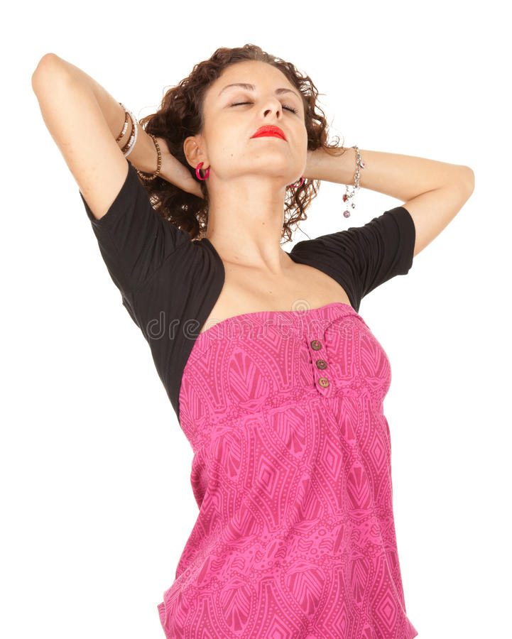 Serious young woman with raised arms