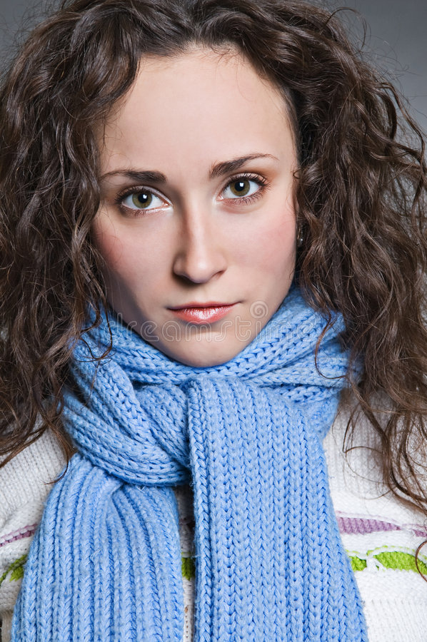 Serious young woman in scarf royalty free stock photo