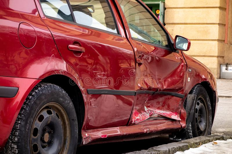 Seriously damaged side door of wine red Skoda Octavia car after traffic accident. OSTRAVA, CZECH REPUBLIC - MARCH 5, 2018: Seriously damaged side door of wine royalty free stock images