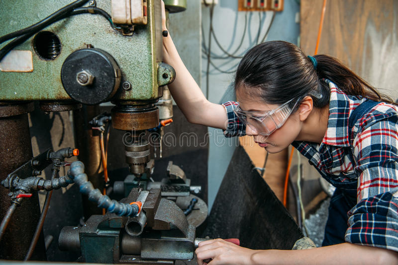 Factory woman wearing safety protection glasses stock image