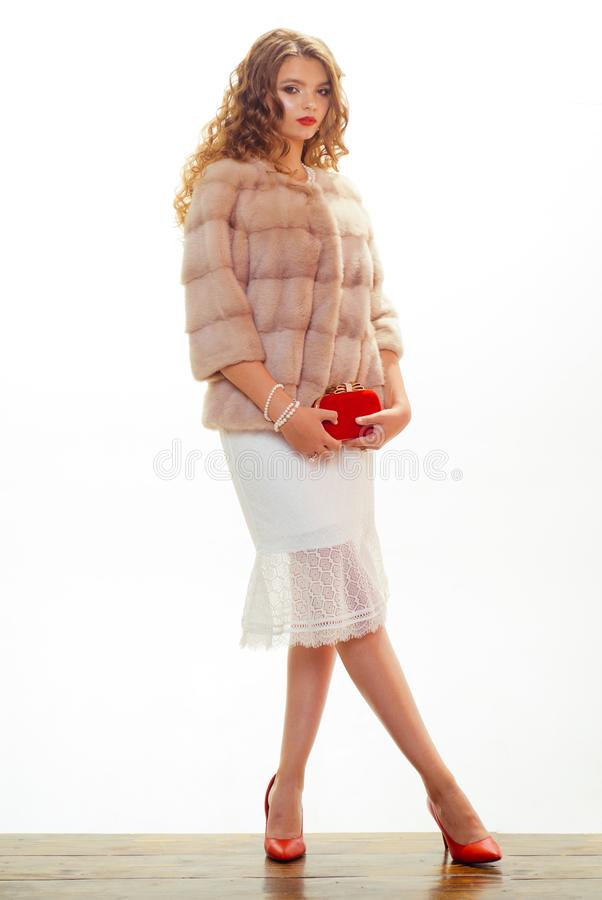 Seriously, this is one nice coat. Pretty woman in fashionable fur coat. Fashion model wear luxurious fur. Winter fashion. Trends. Perfect for winter cold. Young stock photography