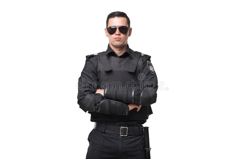 Seriuse cop in sunglasses, uniform with body armor stock images