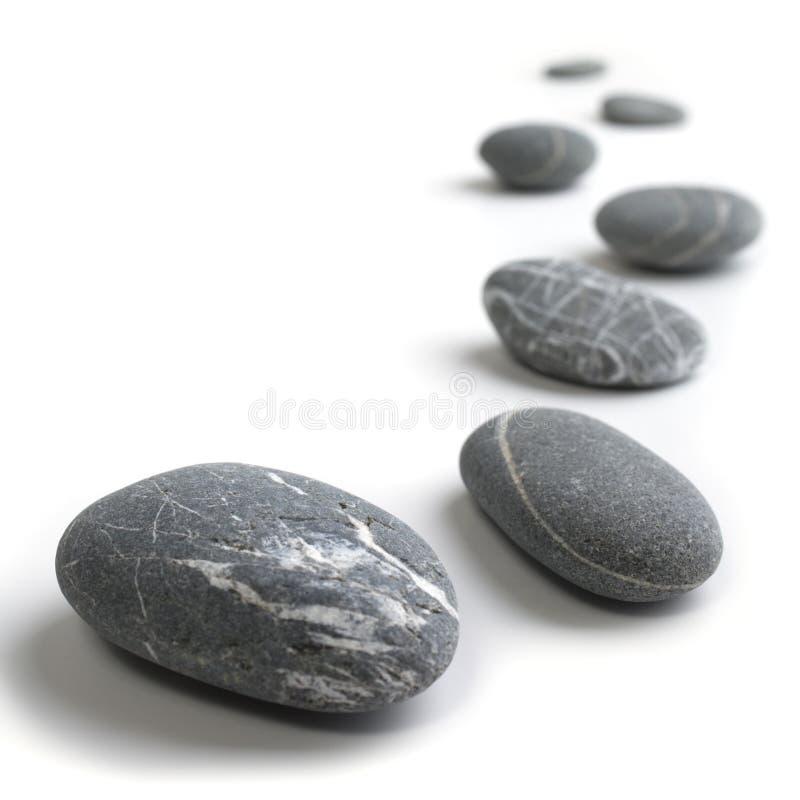 Serpenteando a linha de pedras imagem de stock