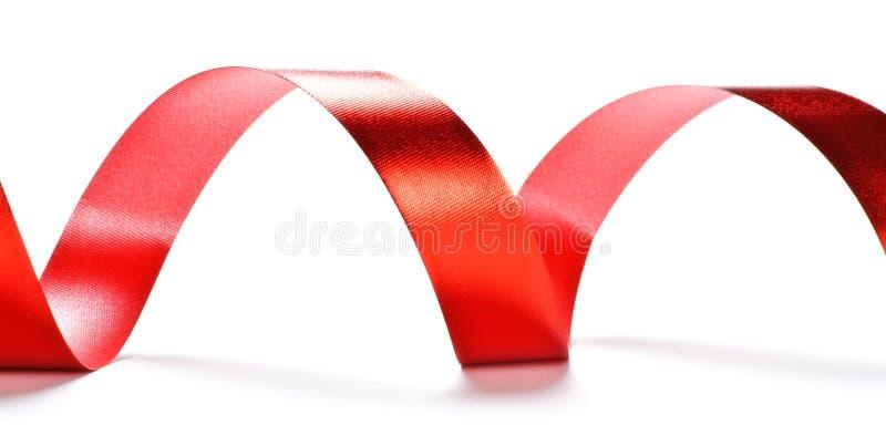 Serpentina roja de la cinta fotos de archivo libres de regalías