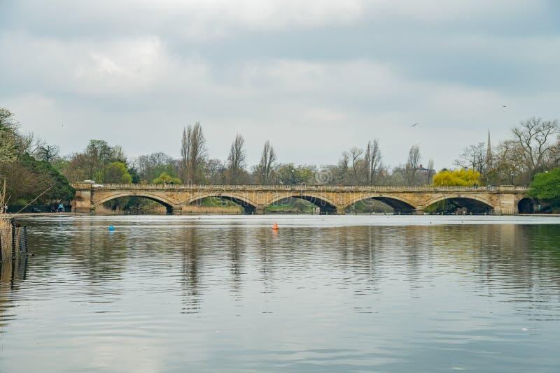 Serpentine Bridge in Hyde Park. At London, United Kingdom stock image