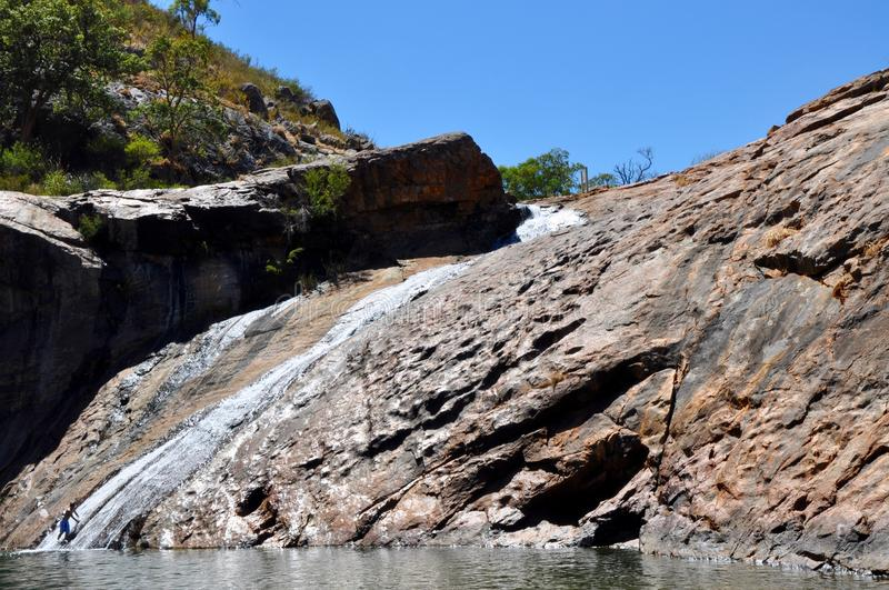 Serpentine Falls, Western Australia. Granite rock face with a trickling waterfall and swimming hole at Serpentine Falls in Serpentine National Park in Western stock images