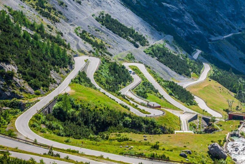 Serpentine mountain road in Italian Alps, Stelvio pass, Passo de stock image