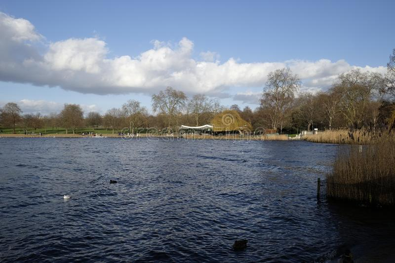 View of The Serpentine, Hyde Park, London,UK. The Serpentine, a recreational lake, very popular with tourists and local people royalty free stock photography