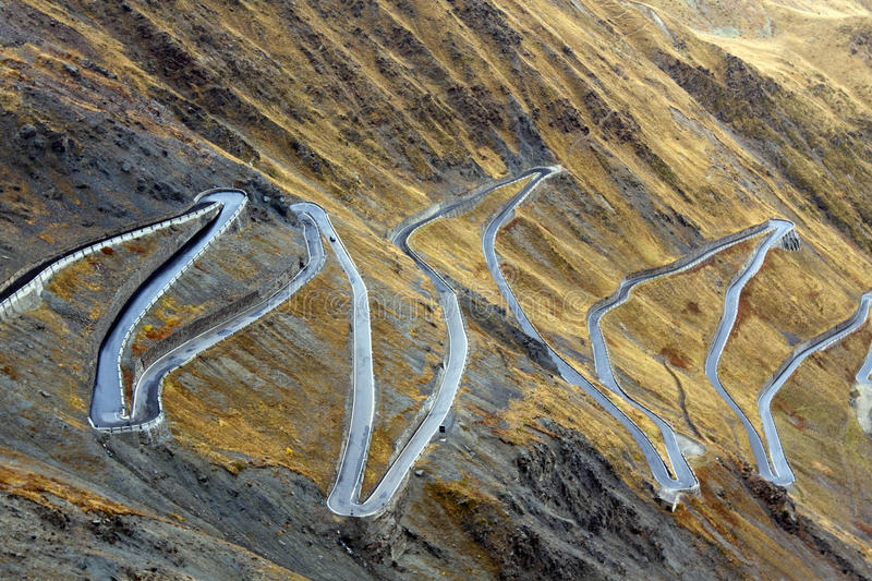 Serpentine road. In the italian Alps leads to Stelvio Pass at 2757 m (9045 ft.) the highest paved mountain pass in the Eastern Alps. The road connects the stock photos