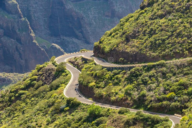 Serpentine road and amazing view of mountain landscape in a sunny day on tropical island. Road adventure trip on the Canary stock photo