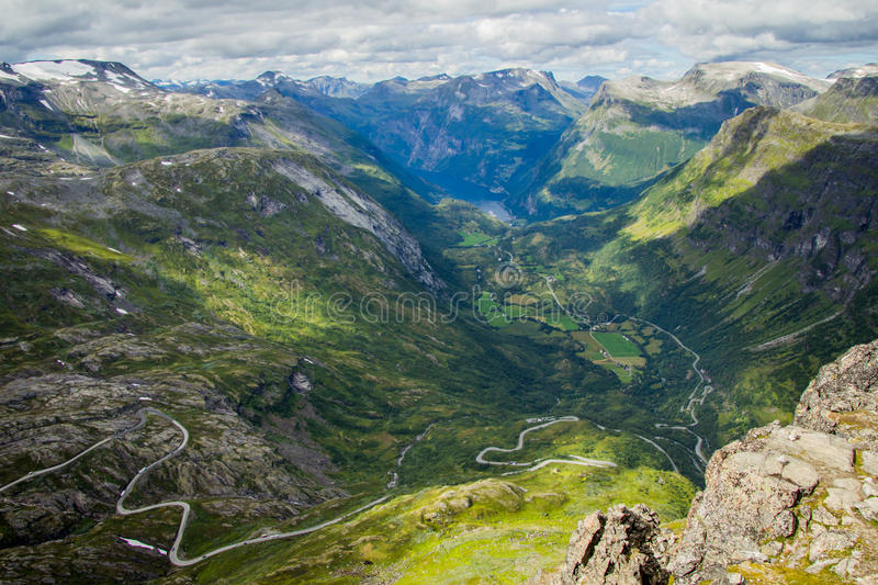 Serpentine roads. Mountain serpentine road view from Geiranger skywalk. Europe's highest fjord view by road – 1500 meter royalty free stock photo