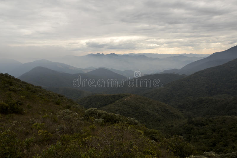Serra fina mountain range with clouds in the winter of minas gerais brazil horizontal. Serra fina mountain range wjile hiking with clouds in the winter of minas stock photo