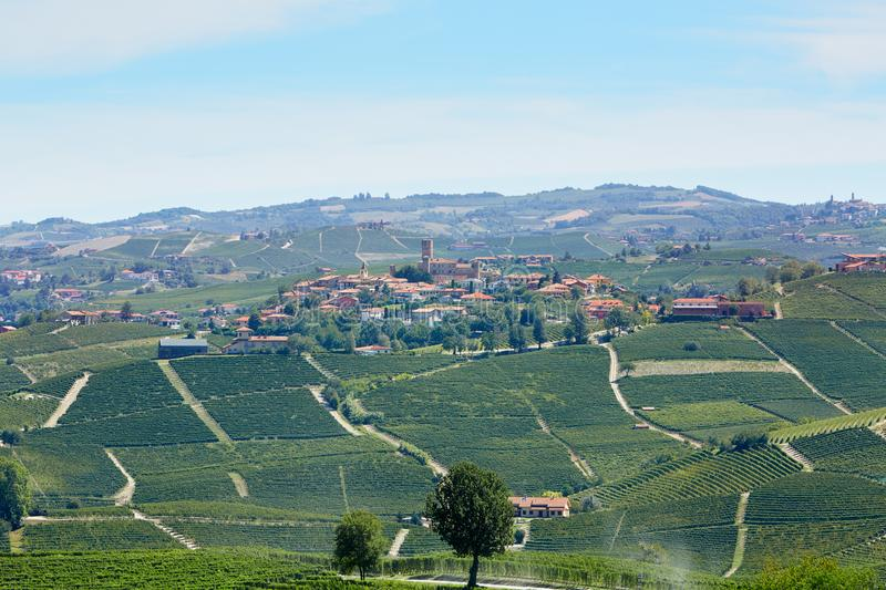 Serralunga Alba town with castle and vineyards in Italy royalty free stock photo