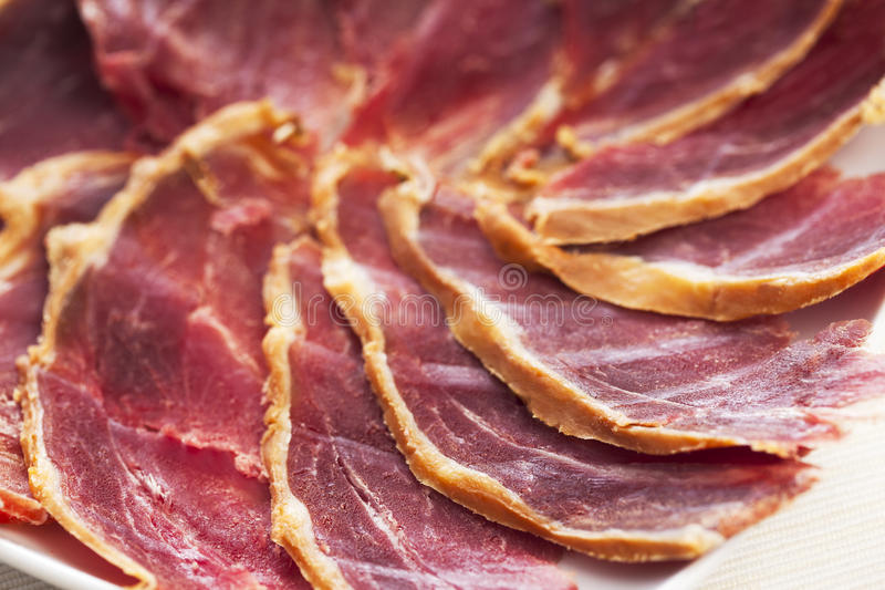Serrano Ham. Slices of a Spanish Serrano cured Ham royalty free stock photo