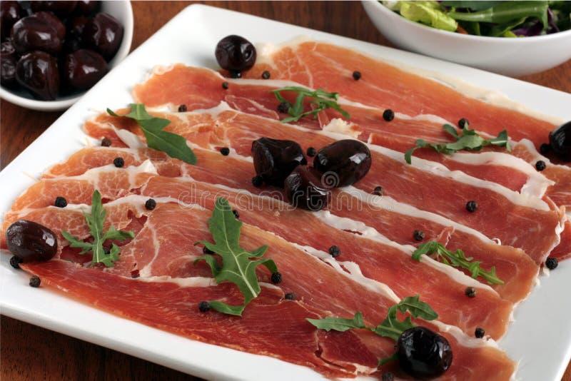 Serrano Ham with Black Olives royalty free stock photo