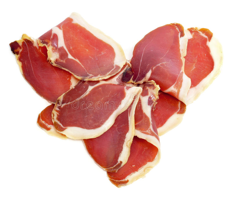 Serrano ham heart. A pile of spanish serrano ham forming a heart stock photos