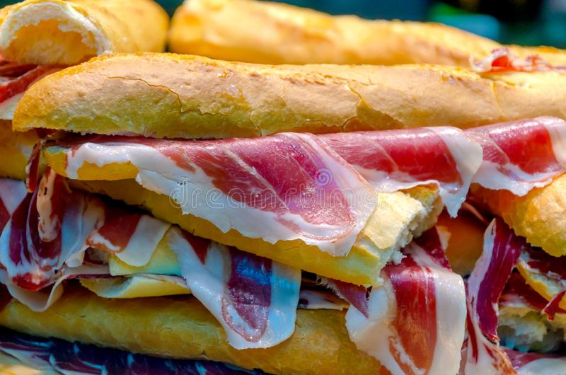 Serrano ham sandwich in a grocery. Typical serrano or iberian ham sandwich in a grocery. Bocadillo de jamon. bellota ham. guijuelo, iberico. Typical spanish stock photos