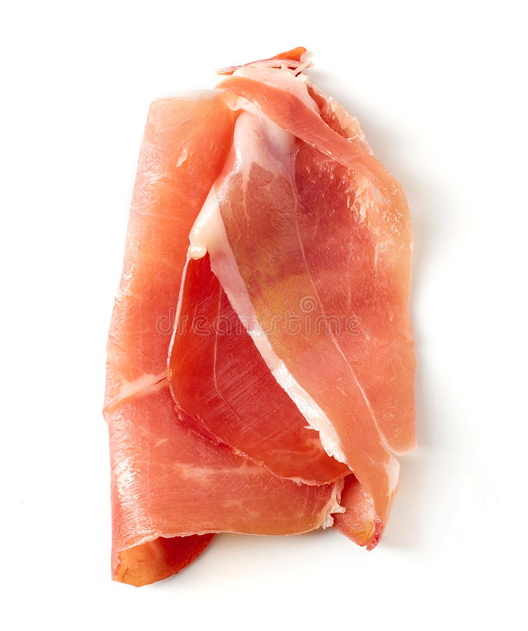 Serrano ham on white background. Slices of serrano ham isolated on white background, top view royalty free stock photo