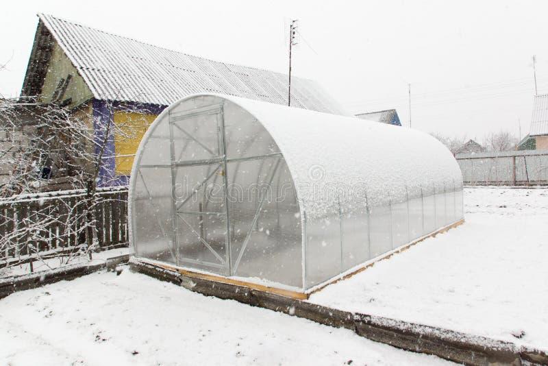 Serre chaude et neige photo libre de droits