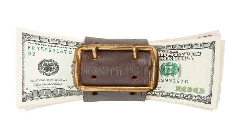Serrez la courroie et la pile de dollars image stock