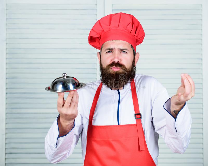 Serve food. Cuisine culinary. man holds kitchen dish tray in restaurant. Healthy food cooking. Mature hipster with beard. Dieting organic food. Happy bearded stock images