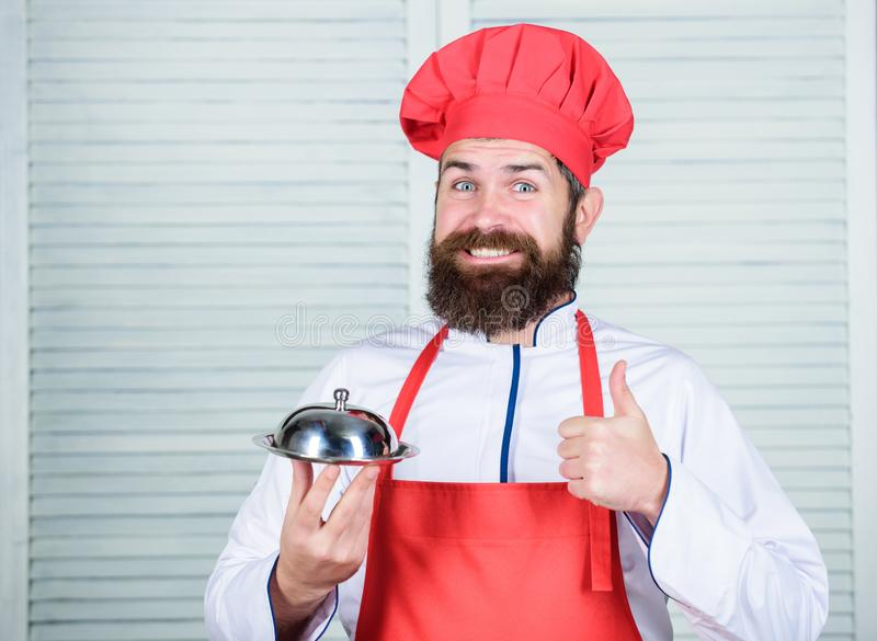 Serve food. Cuisine culinary. man holds kitchen dish tray in restaurant. Healthy food cooking. Mature hipster with beard. Dieting organic food. Happy bearded stock photos