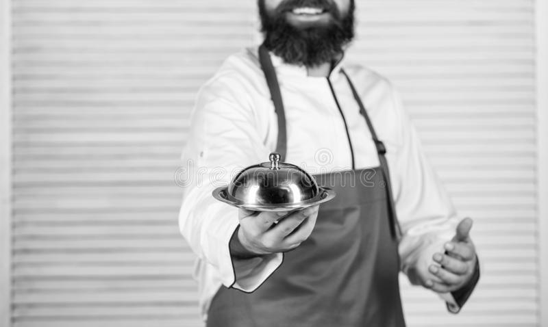 Serve food. Cuisine culinary. man holds kitchen dish tray in restaurant. Healthy food cooking. Mature hipster with beard. Dieting organic food. Happy bearded stock photo