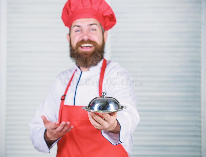 Serve food. Cuisine culinary. man holds kitchen dish tray in restaurant. Healthy food cooking. Mature hipster with beard. Dieting organic food. Happy bearded stock photography