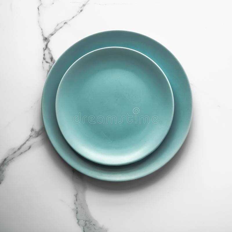Serve the perfect plate. Turquoise empty plate on marble, flatlay - stylish tableware, table decor and food menu concept. Serve the perfect dish stock image