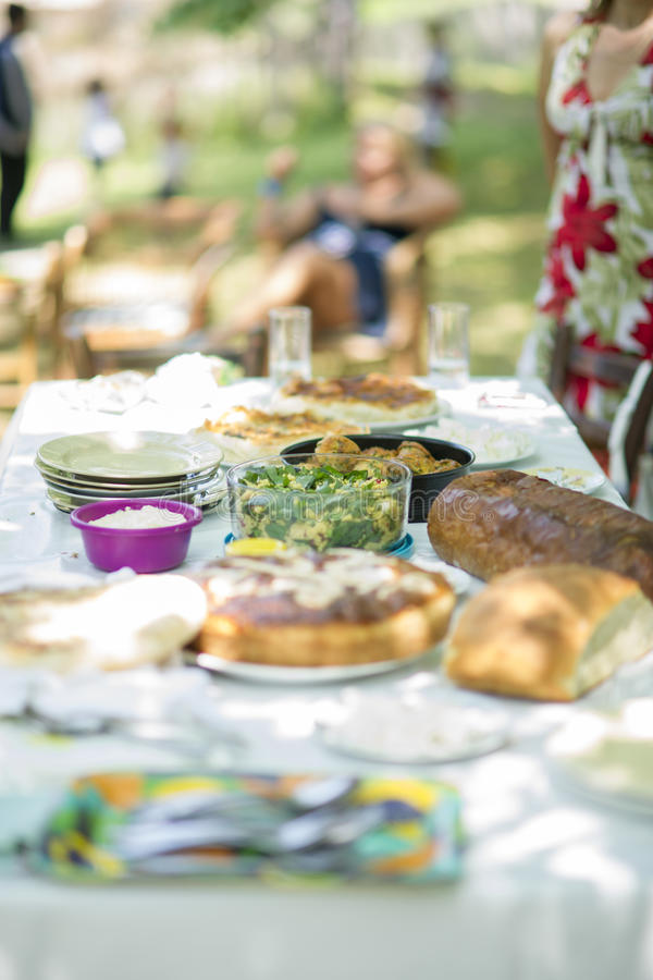Serve table with food for Sunday afternoon lunch. Table with delicious food for Sunday afternoon lunch stock photography