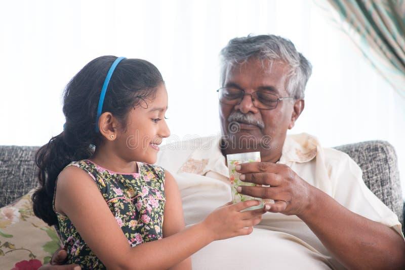 Serve water to elder royalty free stock photo