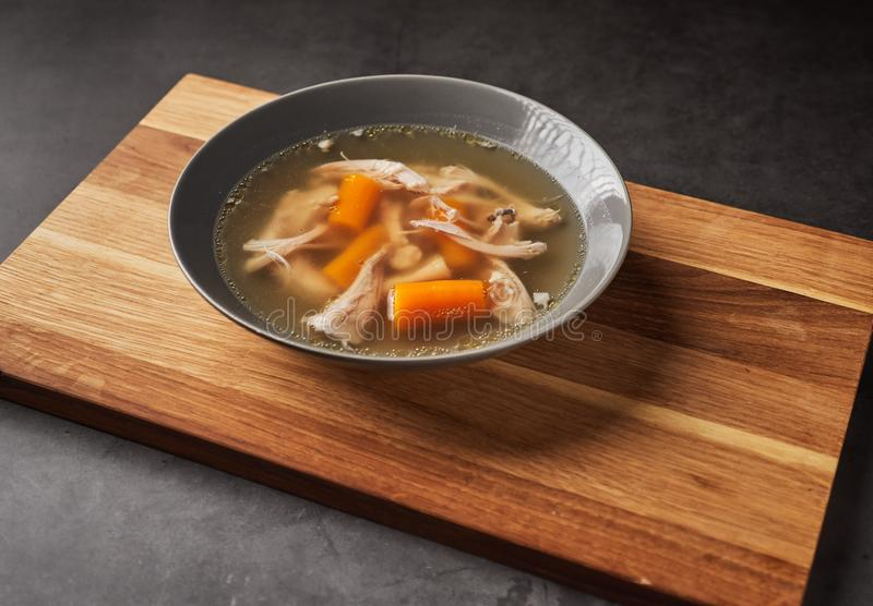 Fresh thick healthy paleo chicken broth soup stock photos