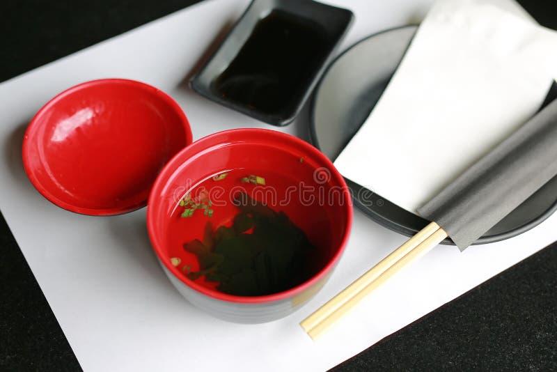 Served japanese style soup misoshiru with fresh seaweed.  royalty free stock photography