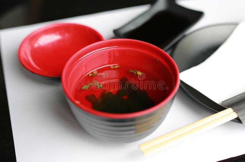 Served japanese style soup misoshiru with fresh seaweed.  stock photography
