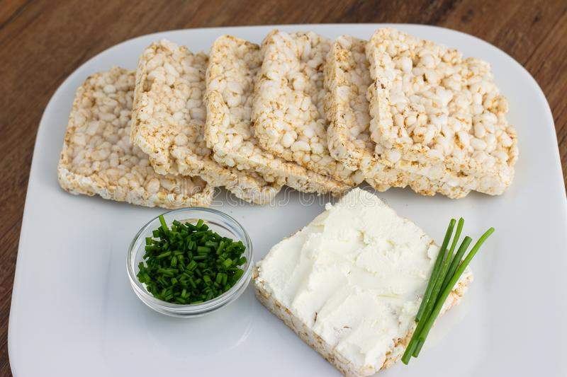Served rice cakes. Rice cakes with cream cheese and chives stock photo