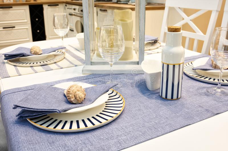 Served table with blue dishes on a blue white tablecloth.  royalty free stock photos