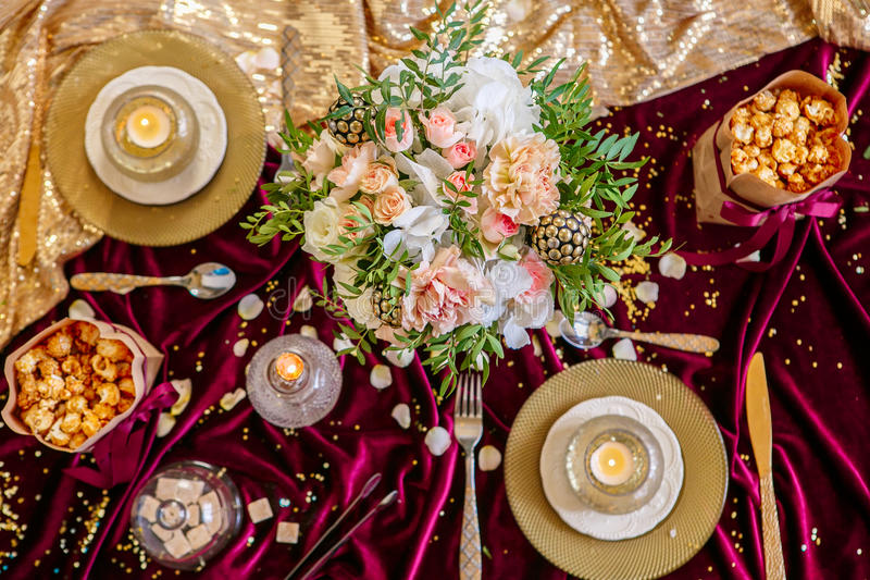 Served table with bouquet and candles stock images